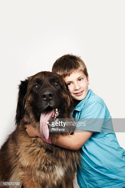 Portrait of a boy hugging his pet dog