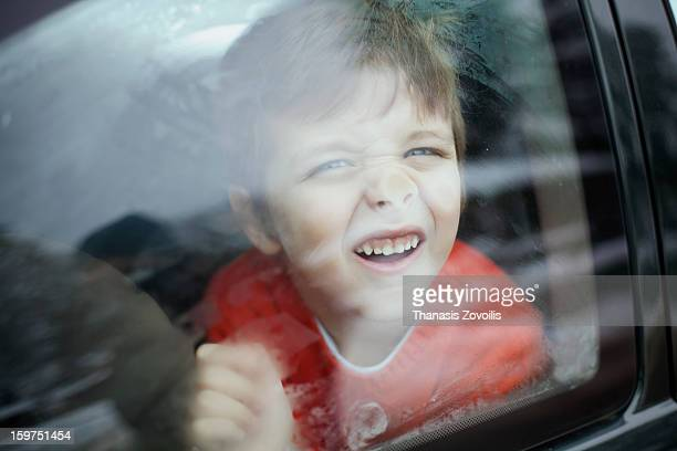 Portrait of a boy in a car