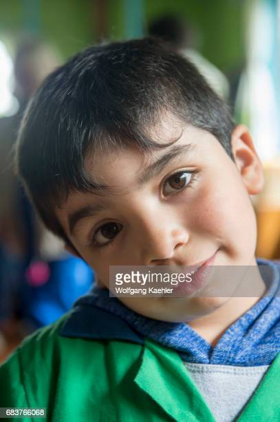A portrait of a boy in a kindergarten in the village of Pargua in the Lake District of Chile