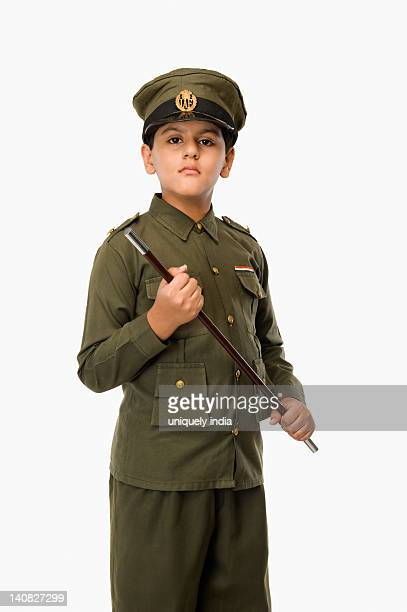 Portrait of a boy in police uniform