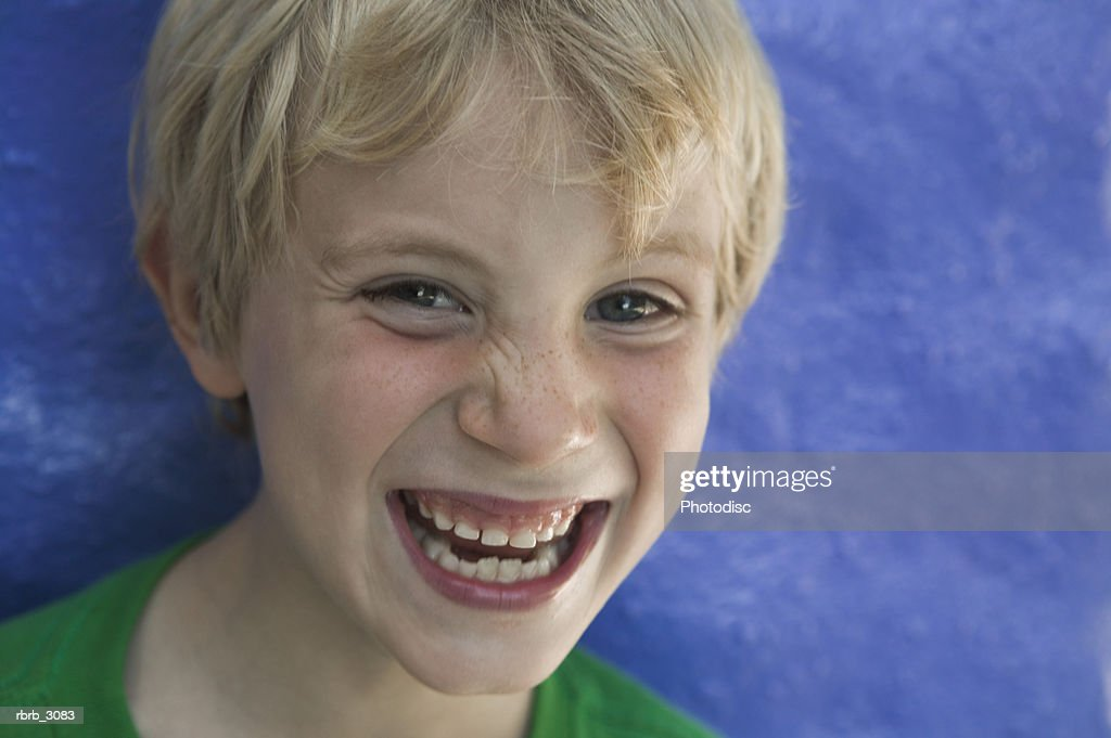 Portrait of a boy laughing : Stockfoto