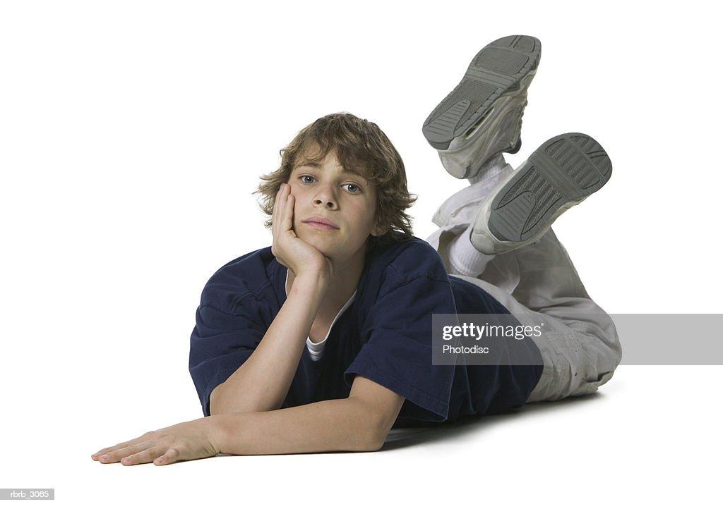 Portrait of a boy lying on the floor : Foto de stock