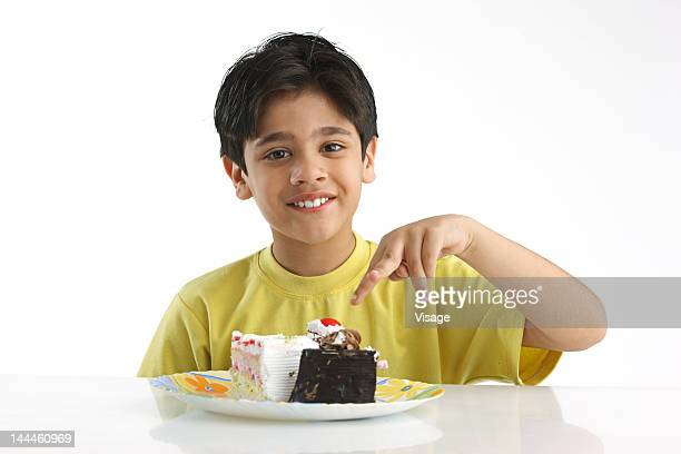 Portrait of a boy, plate of pastries