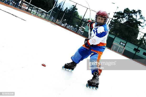 Portrait of a boy playing ice hockey