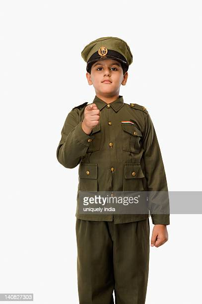 Portrait of a boy pointing in police uniform