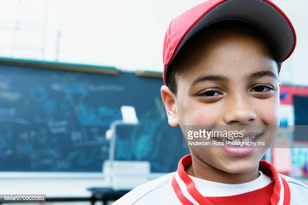 Portrait of a boy smiling in a classroom