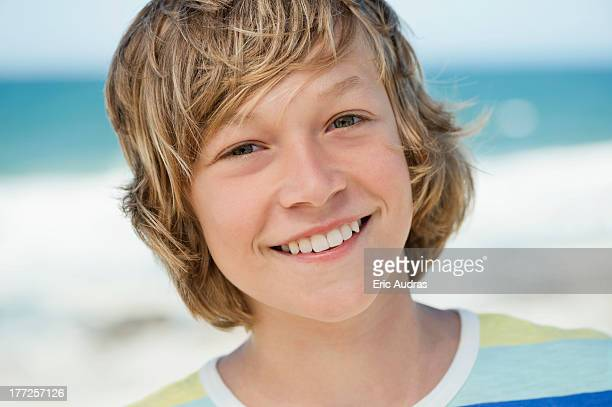 Portrait of a boy smiling on the beach