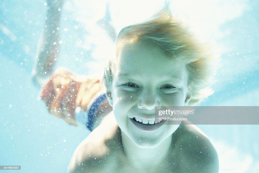 Portrait of a Boy Swimming Underwater : Stock Photo