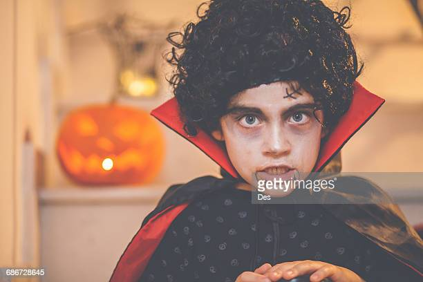 portrait of a boy wearing a halloween dracula costume - count dracula stock photos and pictures