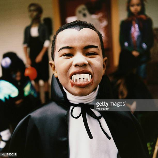 Portrait of a Boy Wearing a Vampire Costume