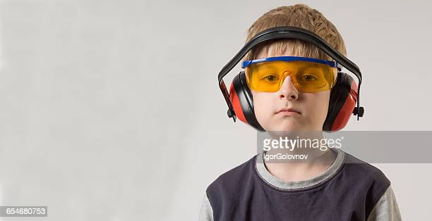 portrait of a boy wearing safety glasses and ear defenders - kids costume engineer stock photos and pictures