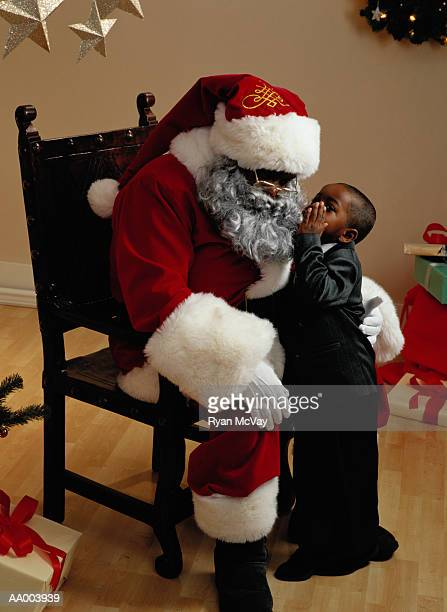 Portrait of a Boy Whispering to Santa Claus
