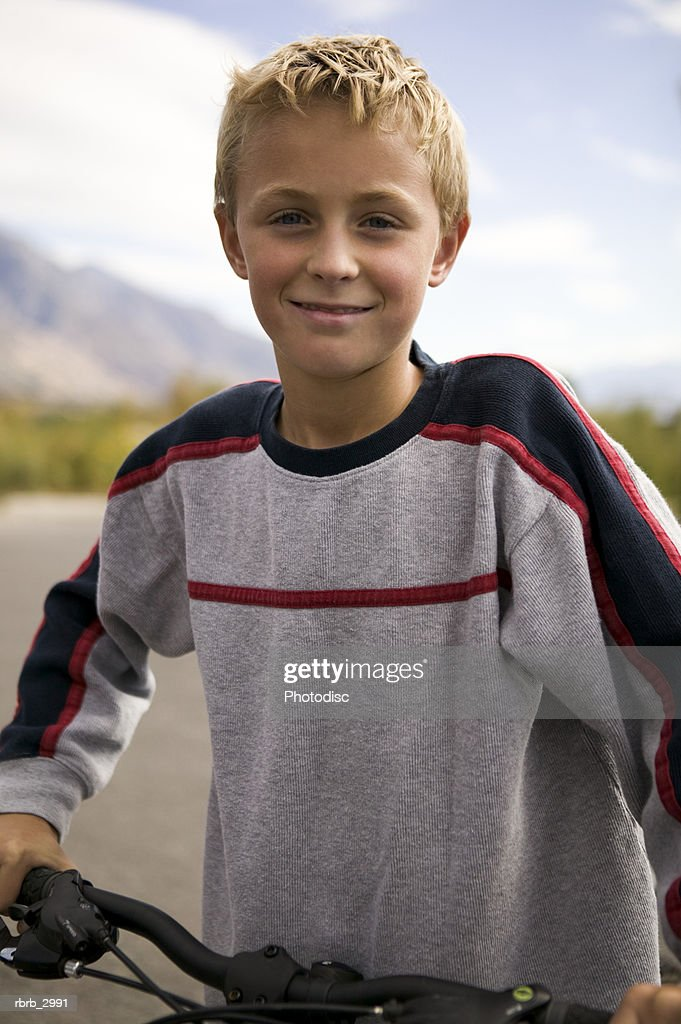 Portrait of a boy with a bicycle : Foto de stock