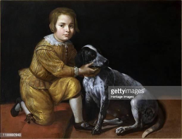 Portrait of a boy with a dog. Private Collection. Artist Fiasella, Domenico .