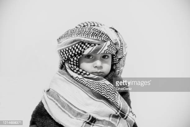 portrait of a boy with a puchile fur - kaffiyeh stock pictures, royalty-free photos & images