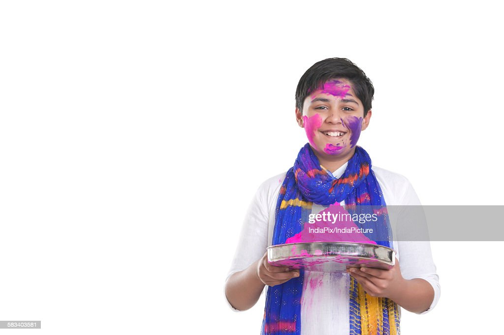 Portrait of a boy with a thali of holi colour : Stock Photo