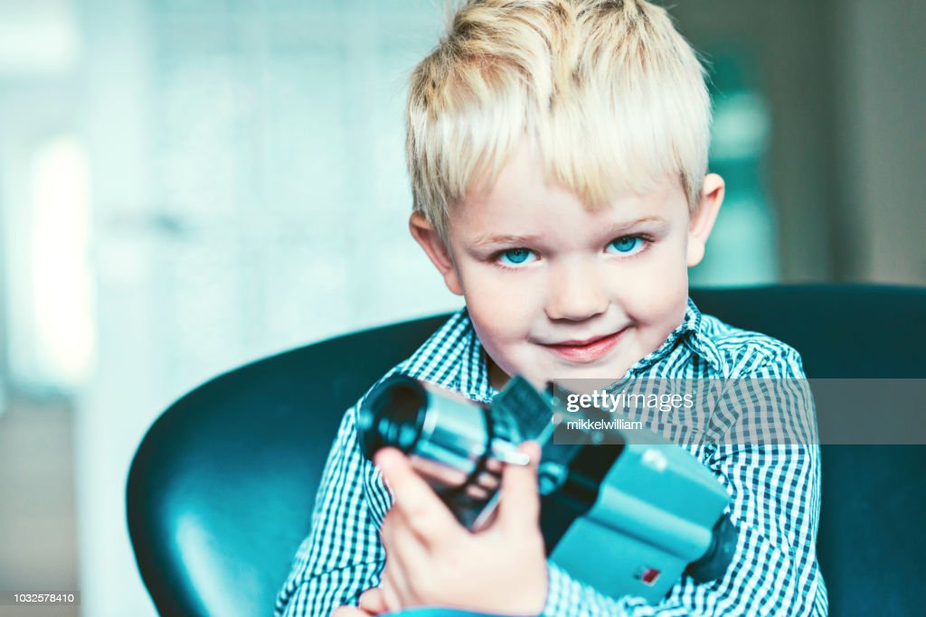 Portrait of a boy with an old video camera : Stock Photo