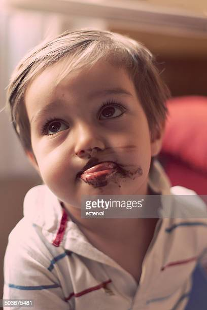 Portrait of a boy with chocolate ice-cream on his mouth