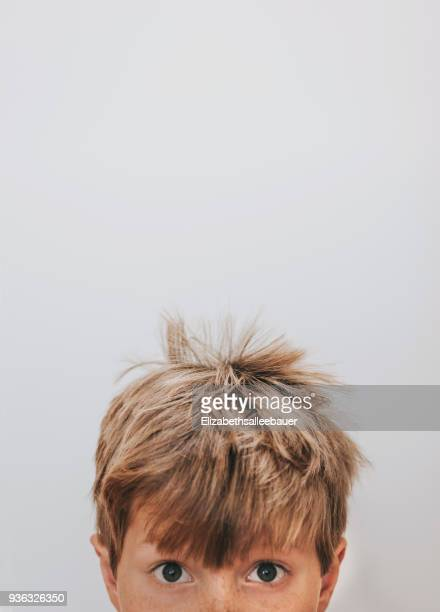 portrait of a boy with freckles and bed hair - high section stock pictures, royalty-free photos & images