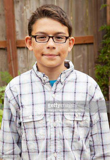 Portrait Of A Boy With Freckles And Eyeglasses