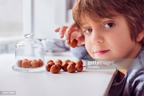 Portrait of a boy with hazelnuts