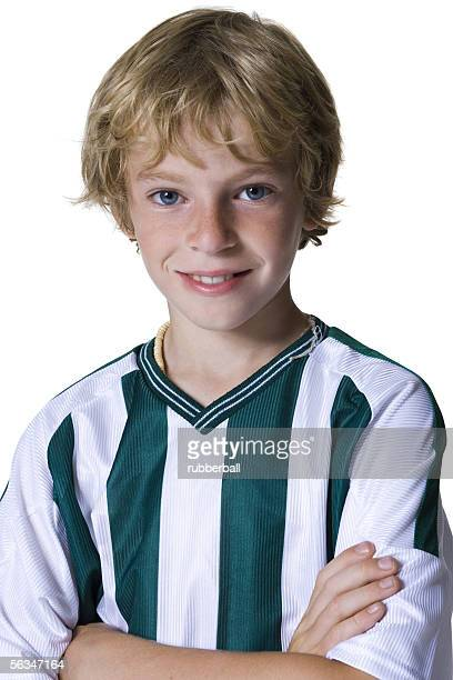 Portrait of a boy with his arms folded