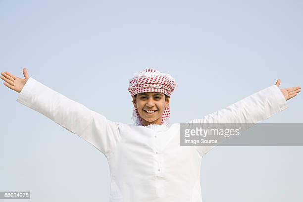 portrait of a boy with his arms open - cultura árabe fotografías e imágenes de stock