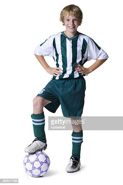Portrait of a boy with his foot on a soccer ball