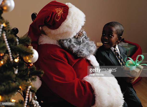Portrait of a Boy With Santa Claus