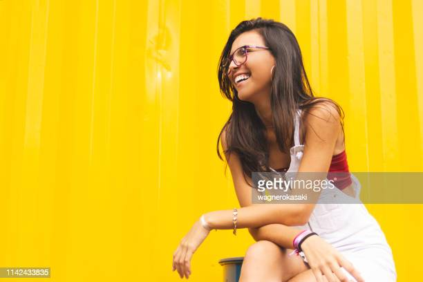 portrait of a brazilian girl looking at somewhere away - straight hair stock pictures, royalty-free photos & images