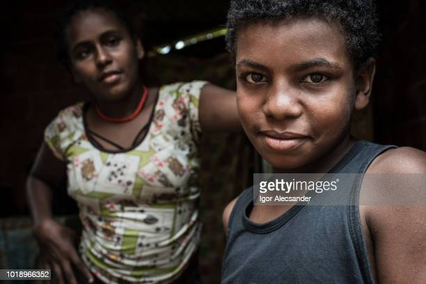 portrait of a brazilian teenagers at home - favela stock pictures, royalty-free photos & images