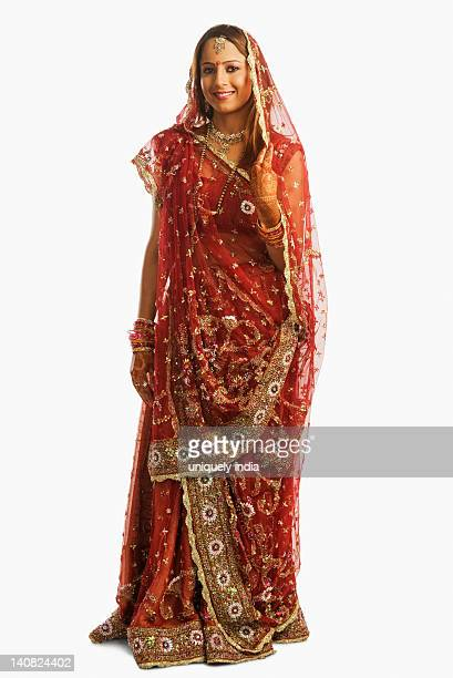 portrait of a bride in traditional wedding dress - hinduism stock pictures, royalty-free photos & images