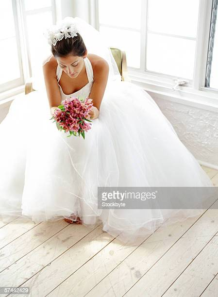 portrait of a bride sitting with a bouquet of flowers - impatience flowers stock pictures, royalty-free photos & images