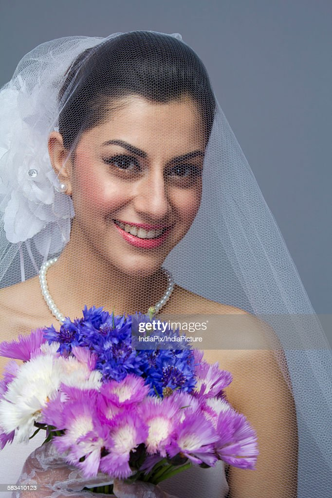 Portrait of a bride with flowers : Stock Photo