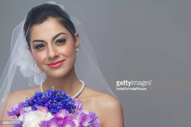 Portrait of a bride with flowers