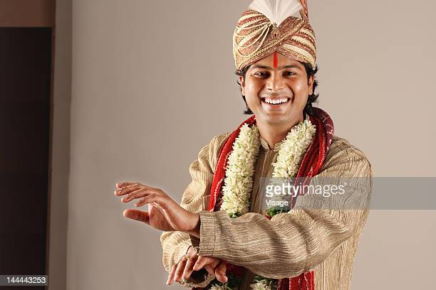 Portrait of a bridegroom dancing