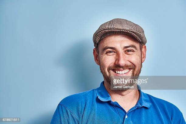 portrait of a british early 30's male smiling - polo shirt stock pictures, royalty-free photos & images
