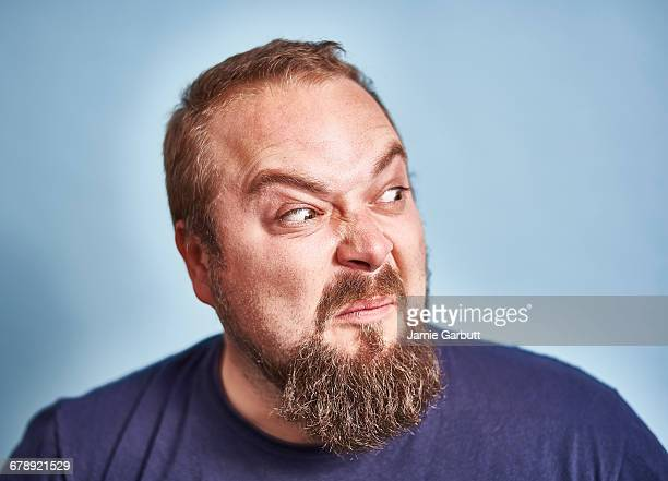 portrait of a british early 30's with a beard - pulling funny faces stock pictures, royalty-free photos & images