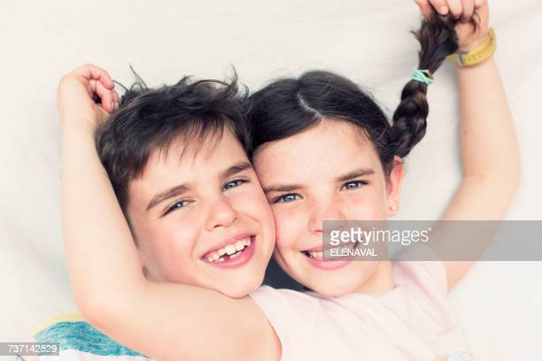 Portrait of a brother and sister smiling