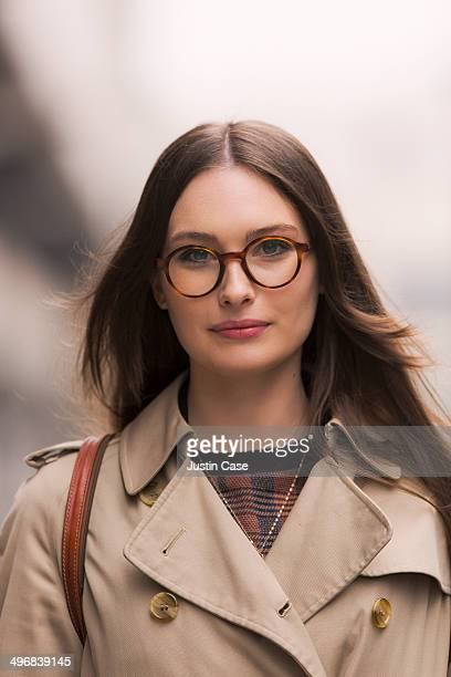 portrait of a brunette smiling woman with glasses - thick rimmed spectacles stock photos and pictures