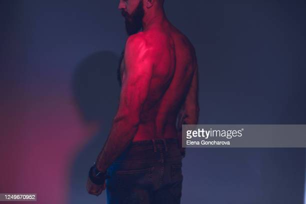 portrait of a brutal bearded man with a naked torso. - birthday suit stock pictures, royalty-free photos & images