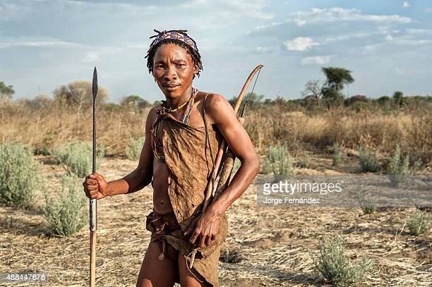 Portrait of a bushmen young men from the Kalahari desert with traditional weapons Botswana