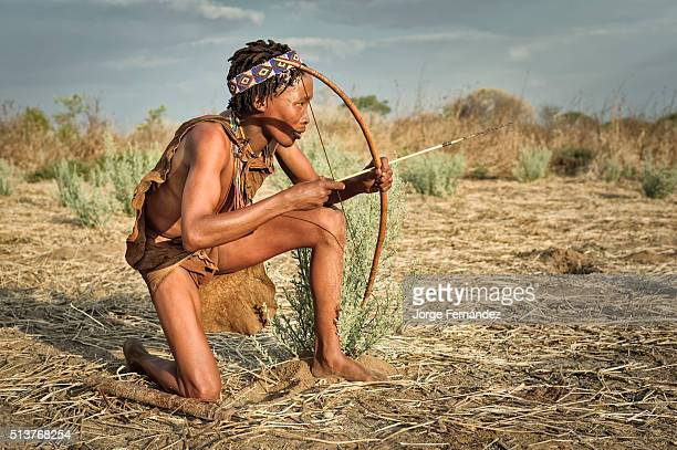 Portrait of a bushmen young men with traditional bow and arrow