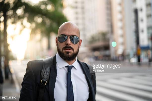 portrait of a business man at city - best sunglasses for bald men stock pictures, royalty-free photos & images