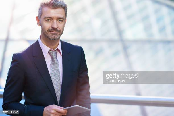portrait of a business man with a digital tablet - full suit stock pictures, royalty-free photos & images