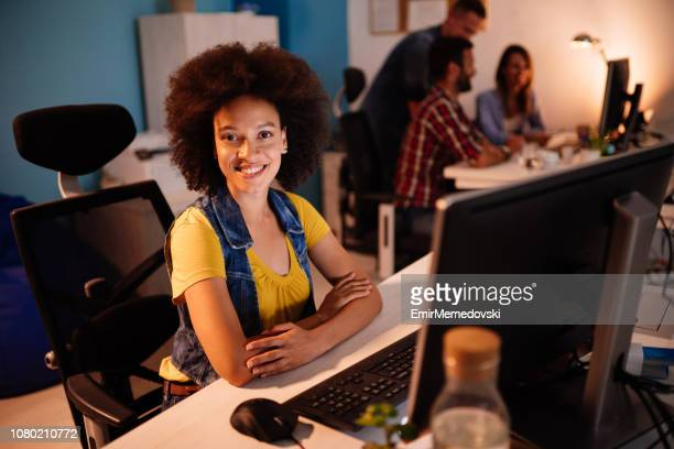 portrait of a business woman at workplace - emir memedovski stock pictures, royalty-free photos & images