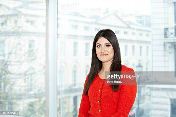 portrait of a business woman in modern office. - cardigan sweater stock pictures, royalty-free photos & images