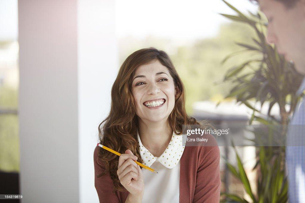 Portrait of a business woman laughing. : Foto de stock