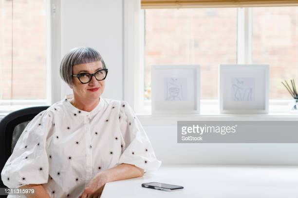 portrait of a business woman. - femalefocuscollection stock pictures, royalty-free photos & images
