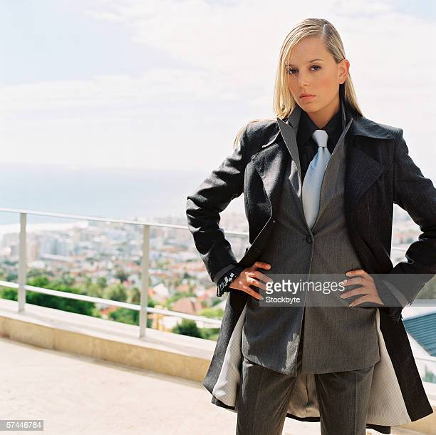 portrait of a business woman standing on a balcony